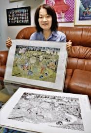 水木しげるさんの妖怪画を手にする長女の原口尚子さん(東京都調布市の水木プロダクション)=共同