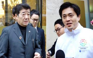 帰国に向けホテルを出発する大阪府の松井知事(写真左)と大阪市の吉村市長(いずれも24日午前、パリ)