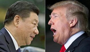 米トランプ大統領(右)と中国の習近平(シー?ジンピン)国家主席=ロイター