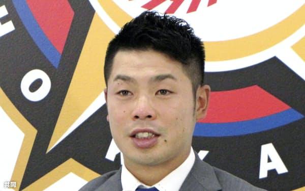 契約更改交渉を終え、記者会見する日本ハムの近藤健介捕手(4日、札幌市の球団事務所)=共同