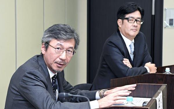 アセットマネジメントOneの武内邦信氏(左)とクレディ・スイス証券の松本聡一郎氏(4日、東京・大手町)