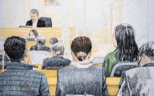 裁判所に出廷したファーウェイの孟晩舟・副会長兼CFO(右から2人目)=Jane Wolsak/カナディアンプレス提供・AP