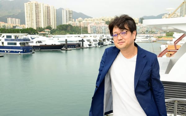 シパンゴの渡辺大輔さんは香港島を望む「ディスカバリー・ベイ」にヒトモノカネを集める構想を掲げる