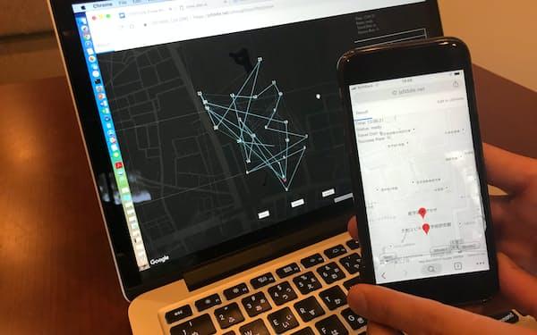 スマートメーターのデータをもとに配送順路をAIが策定。配達員には順路のみスマホ画面(手前)に示す