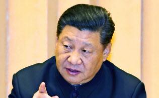 北京で開かれた中央軍事委員会の軍事工作会議で演説する中国の習近平国家主席(4日)=新華社・共同