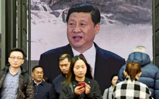 中国の改革開放40周年の展覧会で放映された習近平国家主席の映像(2018年11月、北京)=共同