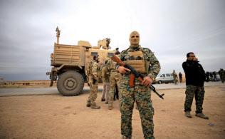 シリア北東部に展開する米軍兵士ら(2018年11月)=ロイター
