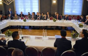25日、スイス・ダボスで開かれたWTO有志国会合=共同