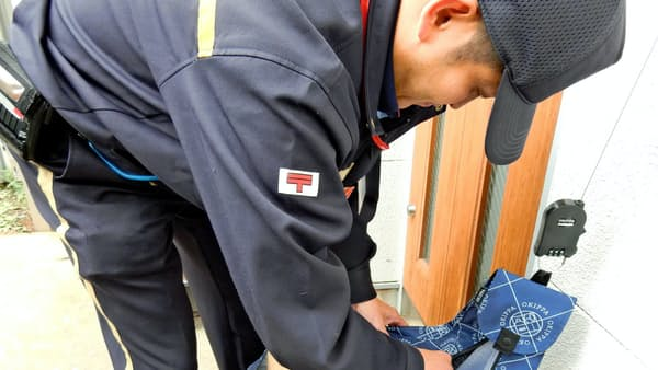 再配達率に15%の壁 玄関前の「置き配」、日本郵便導入