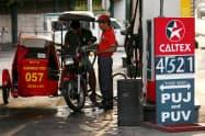 フィリピンでは2018年始めから加速したインフレが一服しつつある(9月、マニラ)=ロイター