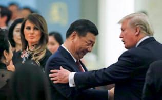 中国企業のトップらは、中国に改革を要求するトランプ大統領(右)は長い目で見れば、中国にとって「最良の友」になると見ている=ロイター