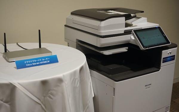 リコーはシスコシステムズの機器(写真左)やサービスでクラウドのセキュリティーを高める