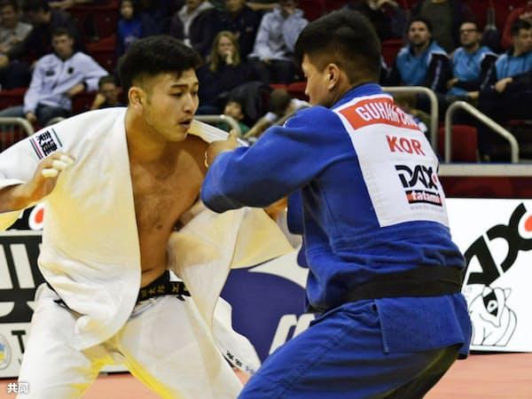 GSデュッセルドルフ大会の男子100キロ級で飯田(左)は強敵を次々と破り優勝した=共同