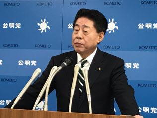 記者会見する公明党の北側中央幹事会会長(14日、東京・新宿)