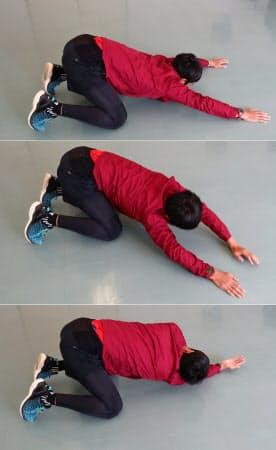 <写真(2)>床に胸を押しつけて左右にしならせる
