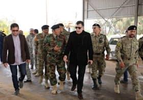 5日、武装勢力から奪還した拠点を視察するリビアのシラージュ暫定首相(右から3人目、トリポリ近郊)=ロイター