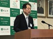 RPAの連携協定について発表する野志克仁市長(9日、松山市)