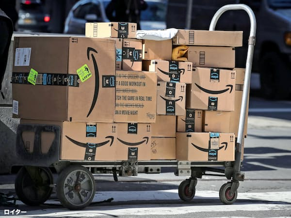 Amazon boxes are stacked on a delivery cart in New York City, U.S., February 14, 2019. REUTERS/Brendan McDermid