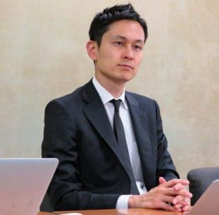説明会に臨むMICIN(マイシン)の原聖吾CEO