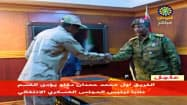 スーダンの暫定軍事評議会の議長に就任したブルハン中将(4月13日のテレビ映像)=ロイター