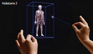 仮想現実をゴーグル越しに見ながら直感的に操作できる(同社提供動画から)