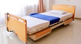 ヘルプパッドはベッドの上に敷いて使い、利用者が違和感を感じにくいという