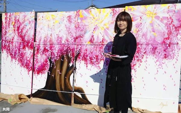 「新しい春」と題した絵を描き上げた絵本作家の神田瑞季さん=共同