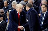 2018年11月にフランスを訪問したトランプ米大統領(左)とマクロン仏大統領=ロイター