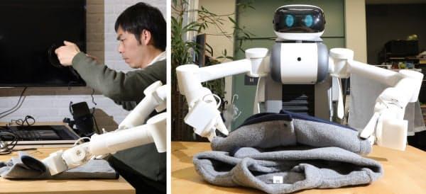 パソナグループが実証実験で家庭に派遣する予定のロボットの改良が進む(写真左)洗濯物を取り出し、干す、たたむまでの一連の動作が可能だ(川崎市高津区のミラロボティクス)