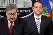 ローゼンスタイン米司法副長官(右)はトランプ大統領とロシア疑惑捜査をめぐり対立していた(18日、ワシントン)=ロイター