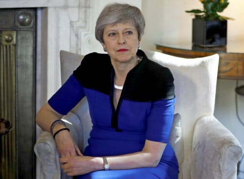 EU離脱問題の決着をつけられないメイ首相への批判は強まっている(ロイター)