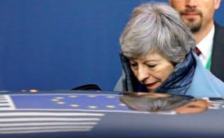 メイ首相は7月末までにEU離脱を実現させたい意向だが、結末は予断を許さない=ロイター