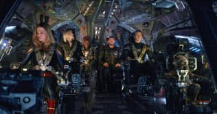 This image released by Disney shows, from left, Brie Larson, Scarlett Johansson, Don Cheadle, Chris Hemsworth, Chris Evans and the character Rocket, voiced by Bradley Cooper, in a scene from