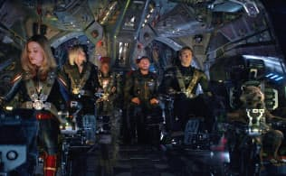 "This image released by Disney shows, from left, Brie Larson, Scarlett Johansson, Don Cheadle, Chris Hemsworth, Chris Evans and the character Rocket, voiced by Bradley Cooper, in a scene from ""Avengers: Endgame."" (Disney/Marvel Studios via AP)"