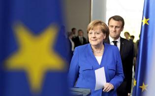 ドイツのメルケル首相(手前)はEUの首脳人事でもフランス政府が考えている人物とは別の候補を推している=AP