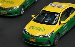 バンコクの街中を走るグラブの車両=柏原敬樹撮影