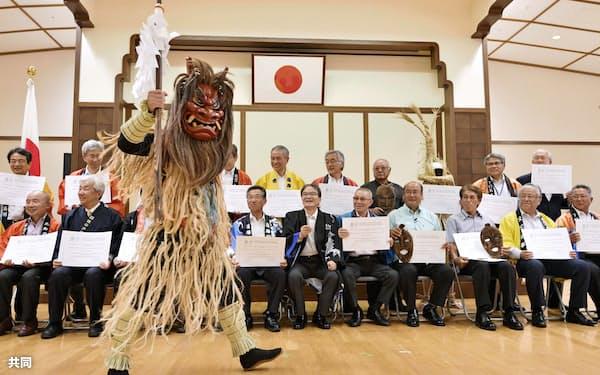 ユネスコ無形文化遺産認定書伝達式にはナマハゲも登場した(27日午後、東京都千代田区)=共同