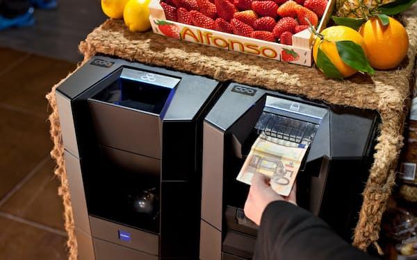 貨幣処理機で欧米の小売店や飲食店の自動化需要を取り込む