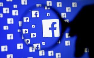 フェイスブックは仮想通貨の開発で米規制当局との協議を始めた=ロイター