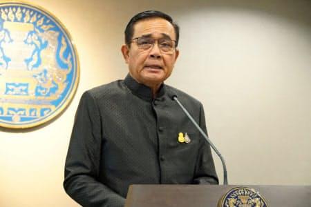 記者会見するタイのプラユット首相(11日、バンコク)