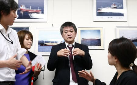 事件概要を報道陣に説明する国華産業の担当者(13日、東京都千代田区)
