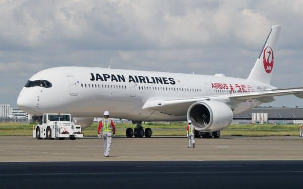 羽田空港に到着した日本航空のエアバスA350-900型機(14日午前)