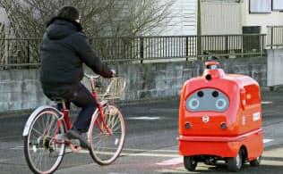 無人配送ロボで公道実験、ヤマトなど参加 法改正視野