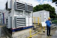 三菱重工業は無電化地域へ太陽光など再生エネルギーを活用しやすい発電設備の提供を始める(24日、神奈川県相模原市)