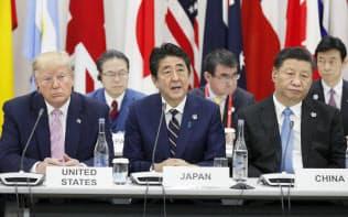 G20サミットで行われたデジタル経済に関する首脳特別イベントであいさつする安倍首相(28日午後、大阪市)=代表撮影