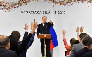 29日、記者会見するロシアのプーチン大統領=ロイター