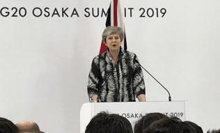 メイ英首相にとっては最後のG20となった(29日、大阪市)