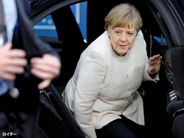 2日、EU首脳会議の会場に到着したドイツのメルケル首相=ロイター