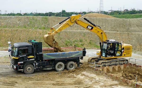 キャタピラーは無人で稼働する建機を開発した(三重県東員町、5日)