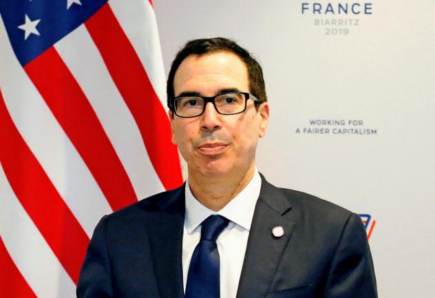 ムニューシン米財務長官はイランのウラン濃縮活動を認めない考えを強調した(18日、パリ近郊)=ロイター